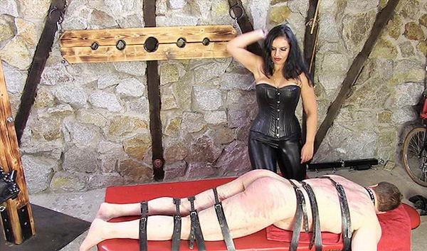 Slave strongly tied to a bed