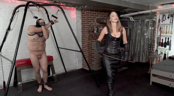 Leather domination over a shackled slave